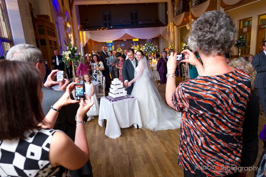 bride_and_groom_cut_the_cake_bedford_boys_school