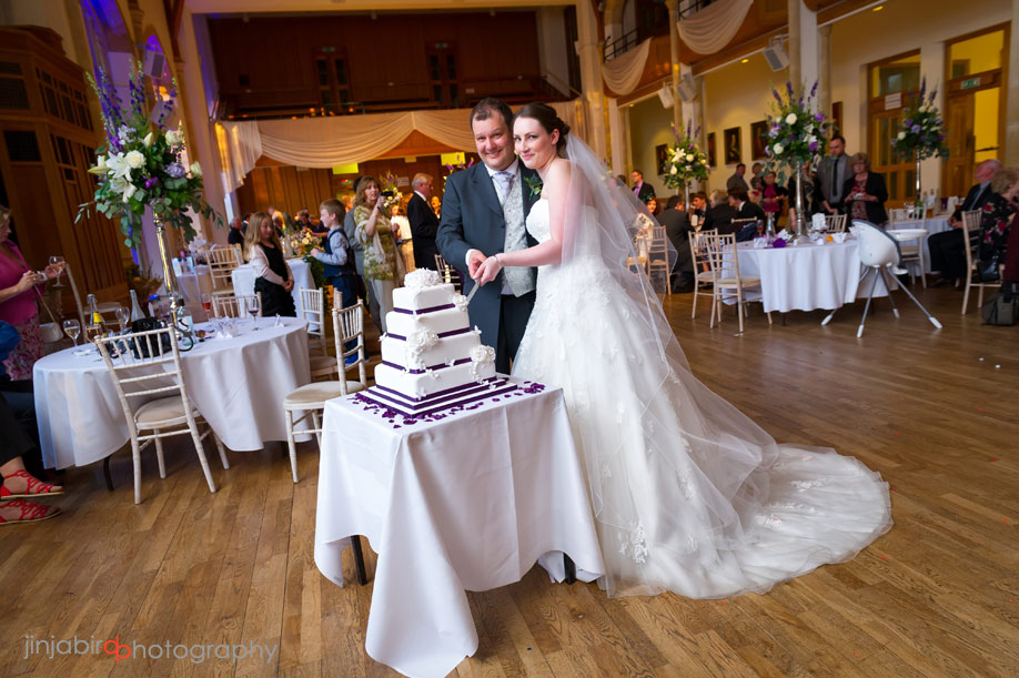 bride_and_groom_cutting_the_cake_bedford_boys_school