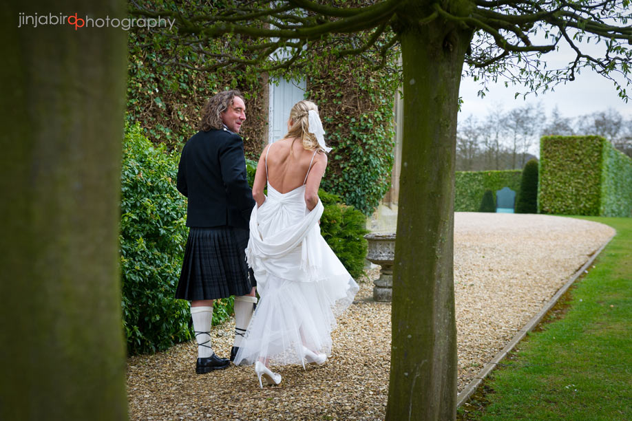 bride_and_groom_walking_fawsley_hall