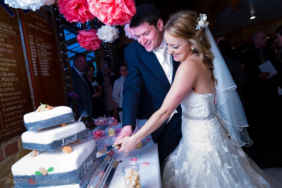 cutting_wedding_cake_abbotsley_golf_club.jpg