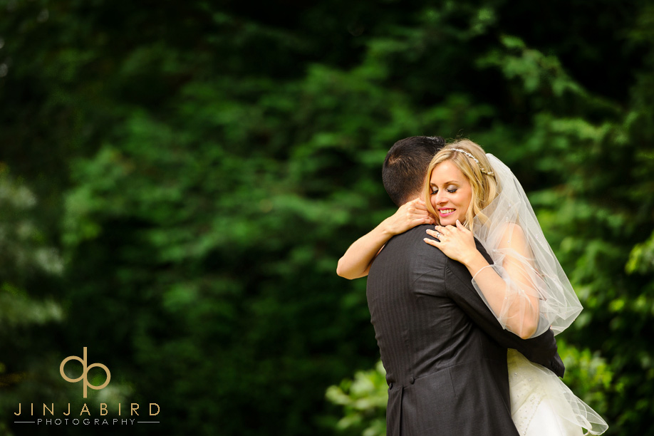 bull_hotel_gerrards_groom_bride_in_garden