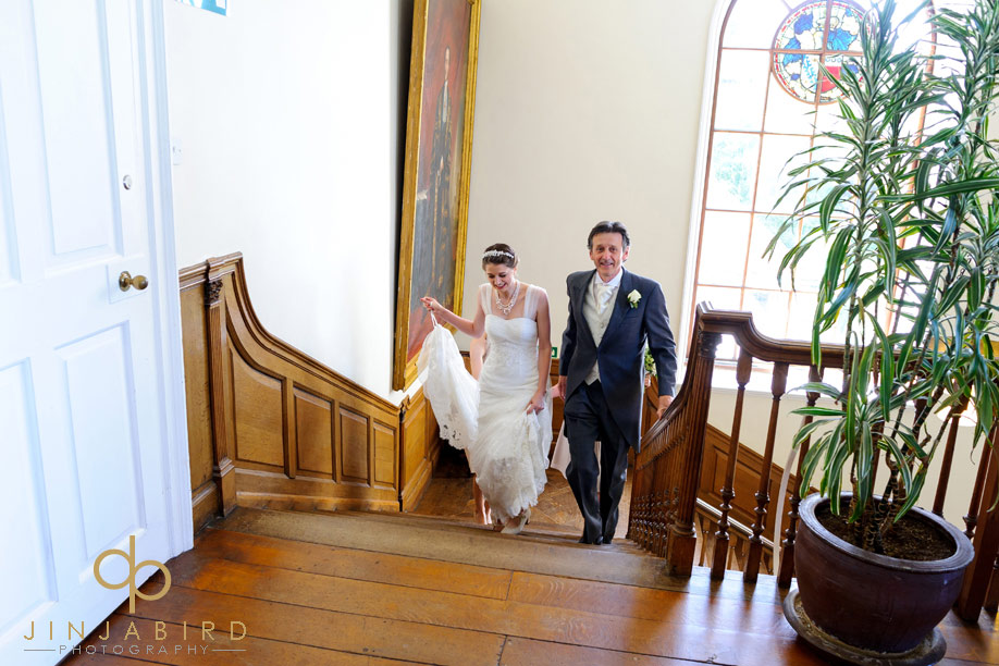 bride_on_stairs_madingley_hall