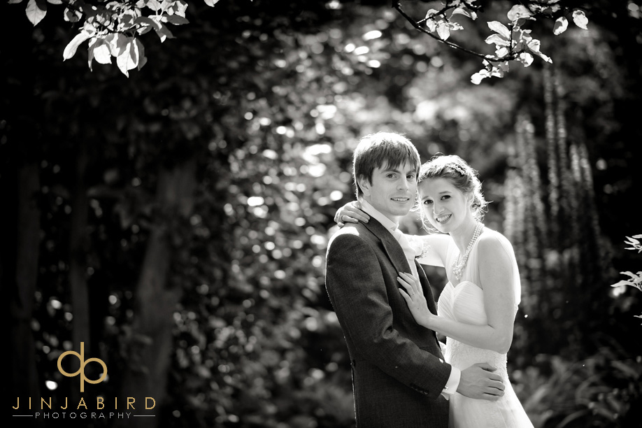 bride_with_groom_madingley_hall_garden