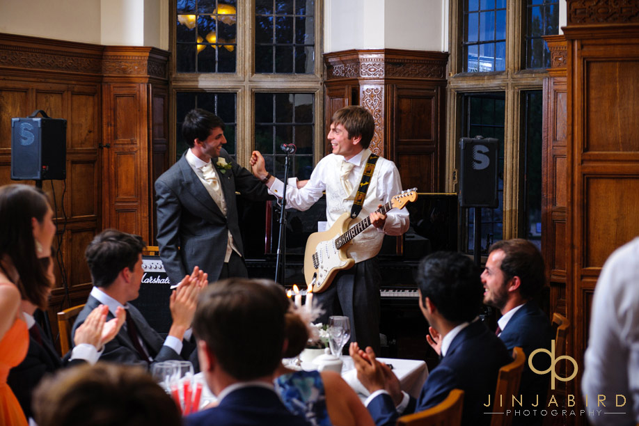 groom_playing_guitar_madingley_hall