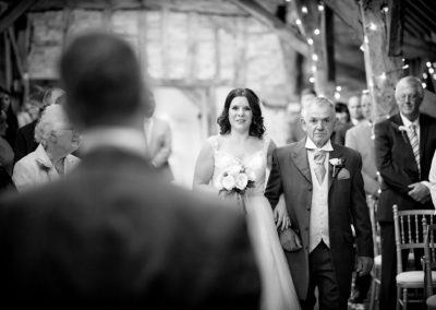 bride-coming-down-aisle-with-father