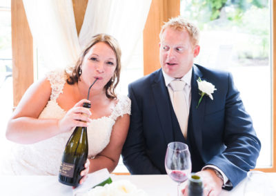 bride-drinking-wine-with-straw