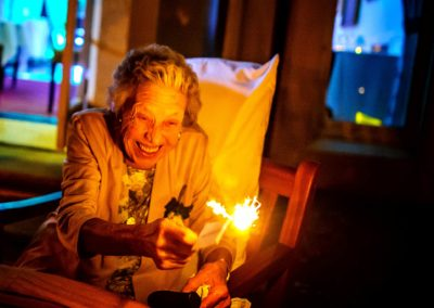 brides-grandmother-holding-sparkler