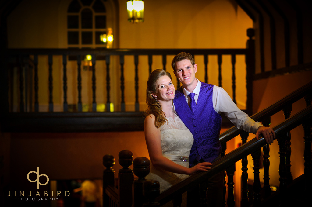 bride-and-groom-on-stairs-hitchin-priory