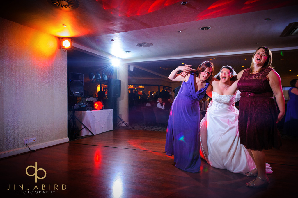 bride-dancing-with-bridesmaids-wyboston-lakes