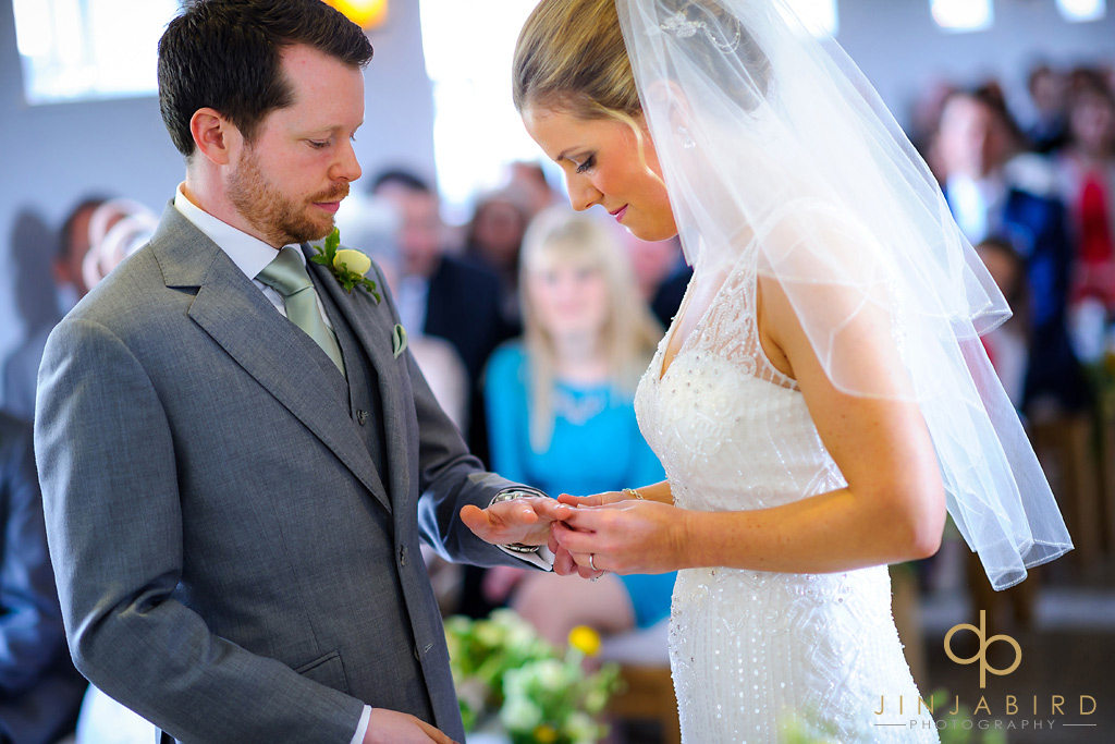 bride-puts-on-wedding-ring-southend-barns