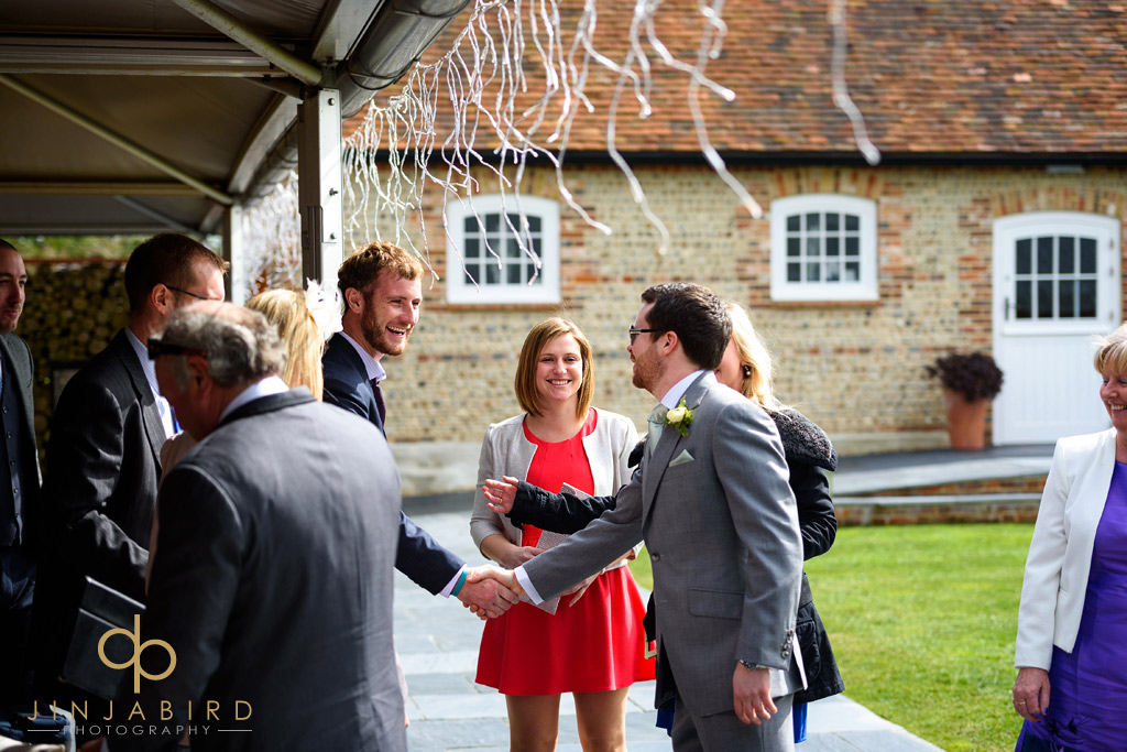 groom-with-guests-southend-barns