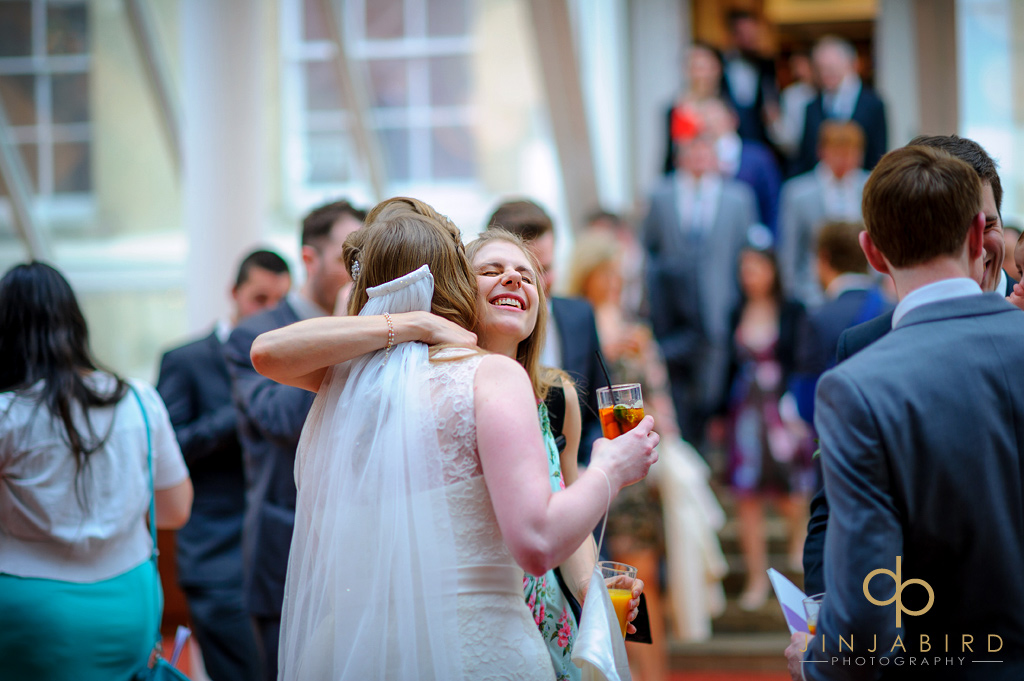 guest-hugging-bride-hitchin-priory