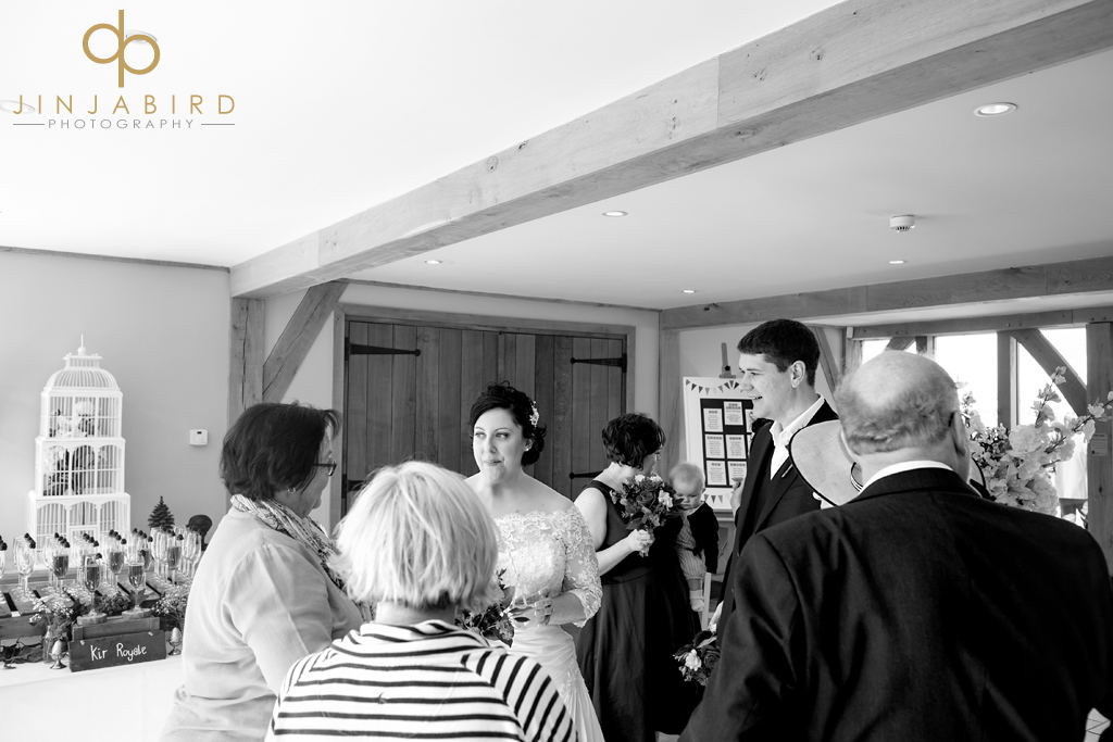 bride-and-groom-with-guests-bassmead-manor-barns