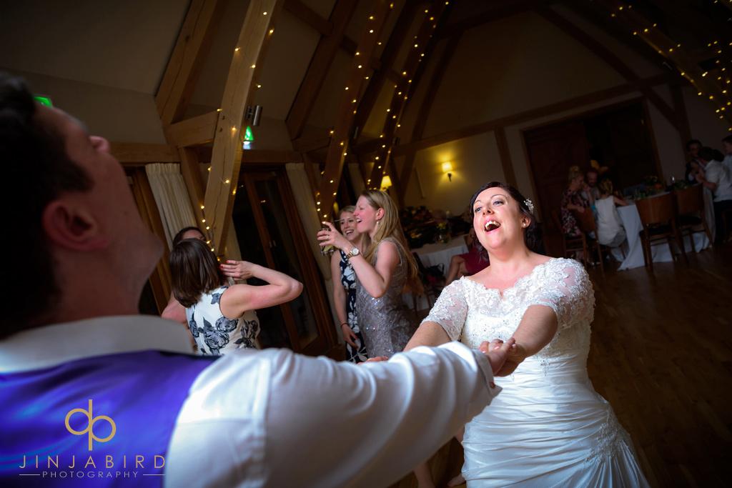 bride-dancing-with-groom-bassmead-manor-barns