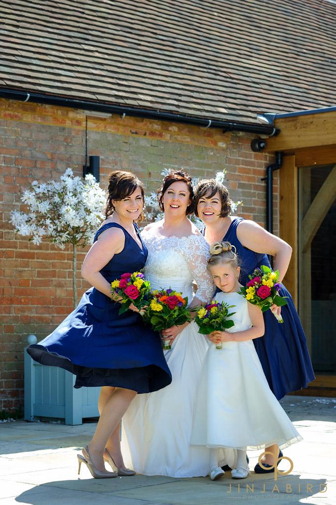 bride-with-bridesmaids-bassmead-manor-barns