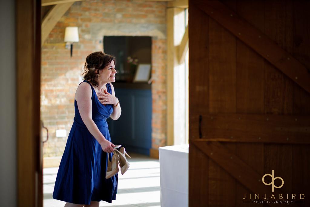 bridesmaid-laughing-bassmead-manor-barns