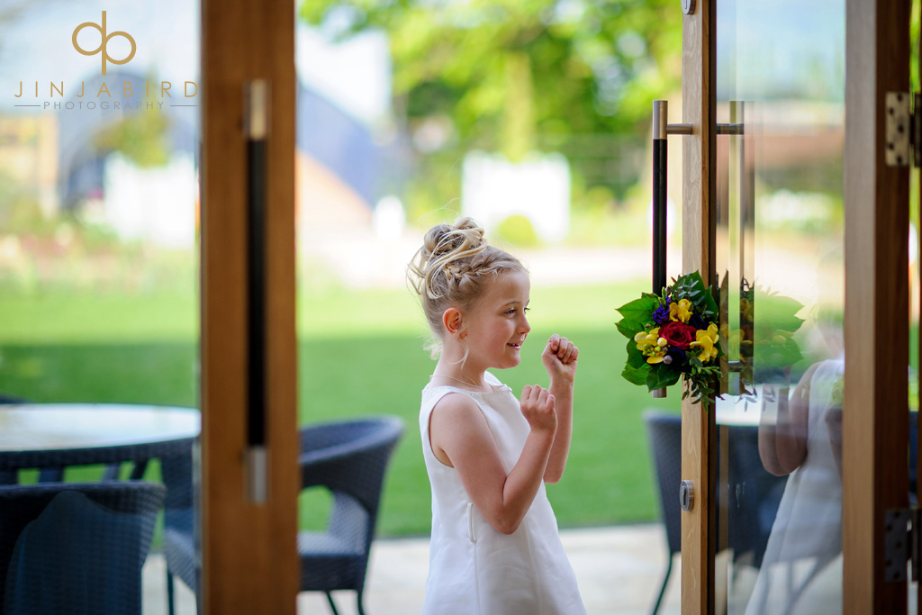 flower-girl-with-bouquet-bassmead-manor-barns