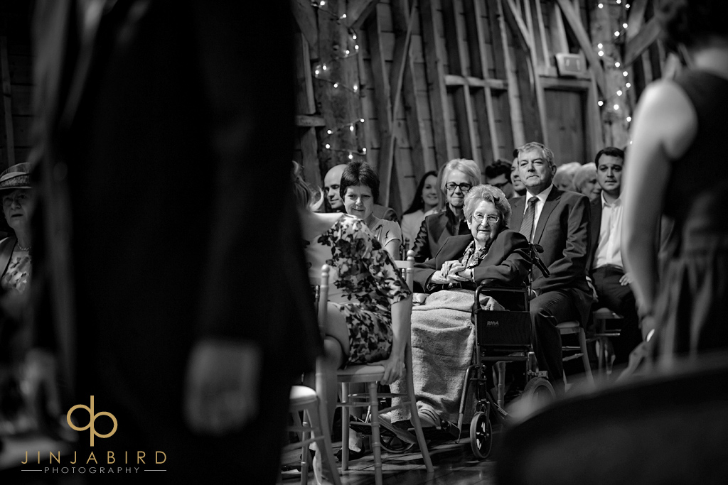 guests-watching-wedding-bassmead-manor-barns