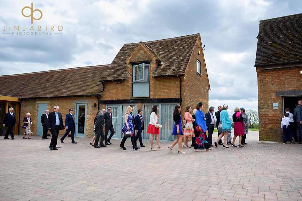wedding-guests-arriving-bassmead-manor-barns