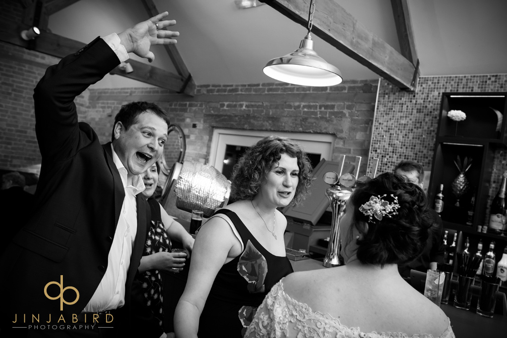 wedding-guests-in-bar-bassmead-manor-barns