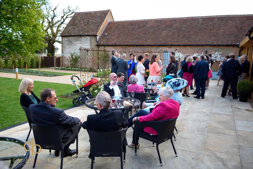 wedding-guests-in-garden-bassmead-manor-barns