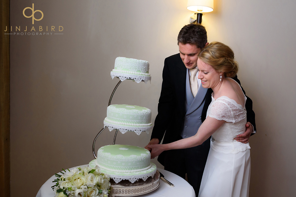 bassemad-manor-barns-cutting-the-wedding-cake