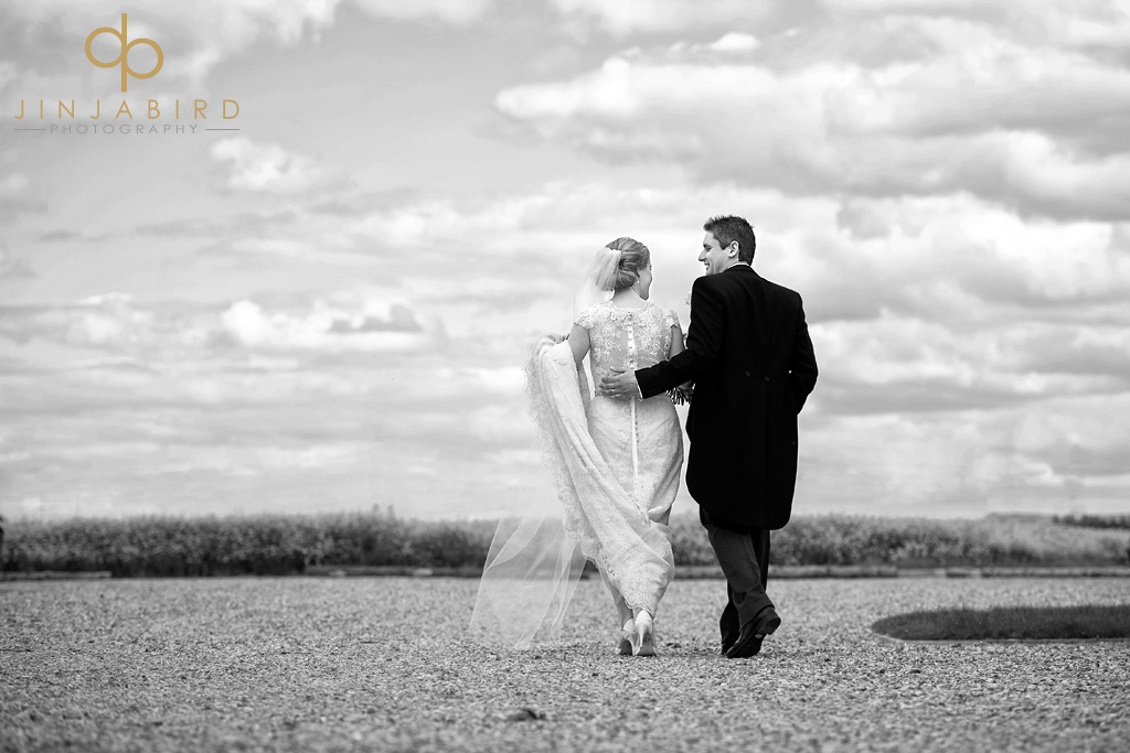 bride-and-groom-walking-bassmead-manor-barns