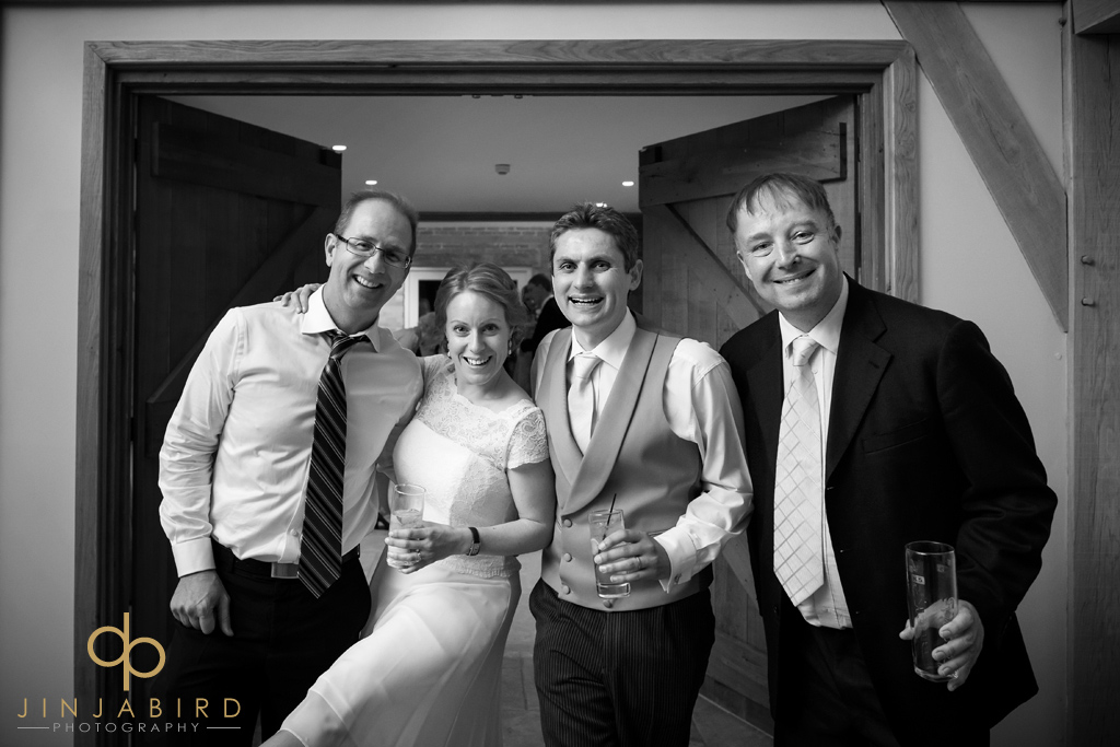 bride-and-groom-with-friends-bassemad-manor-barns