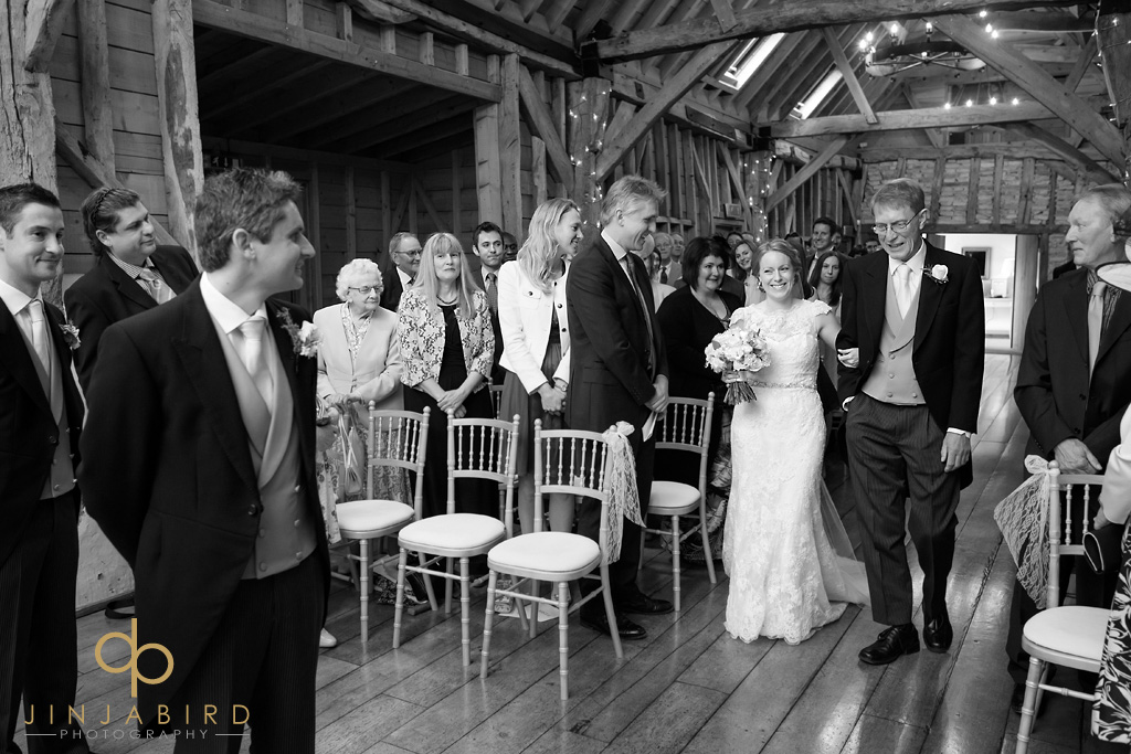 bride-coming-down-aisle-bassmead-manor-barns
