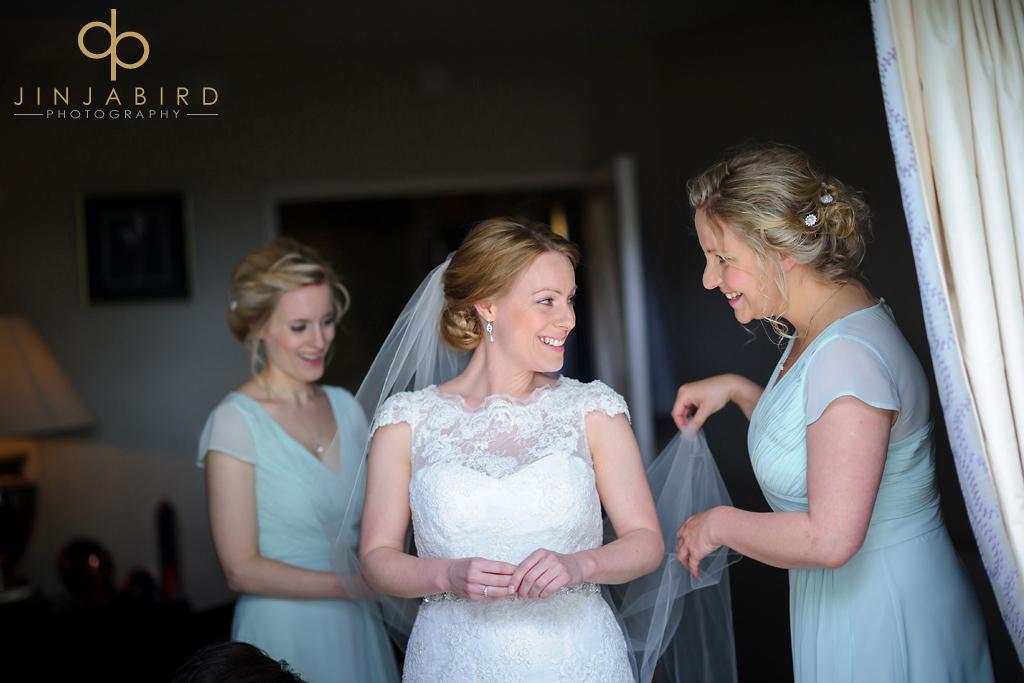 bride-with-bridesmaids-at-bassmead-manor-barns