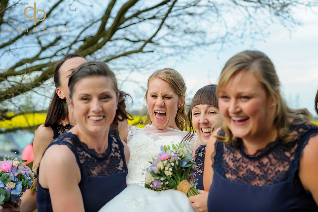 bridesmaids-carrying-bride-bassmead-manor