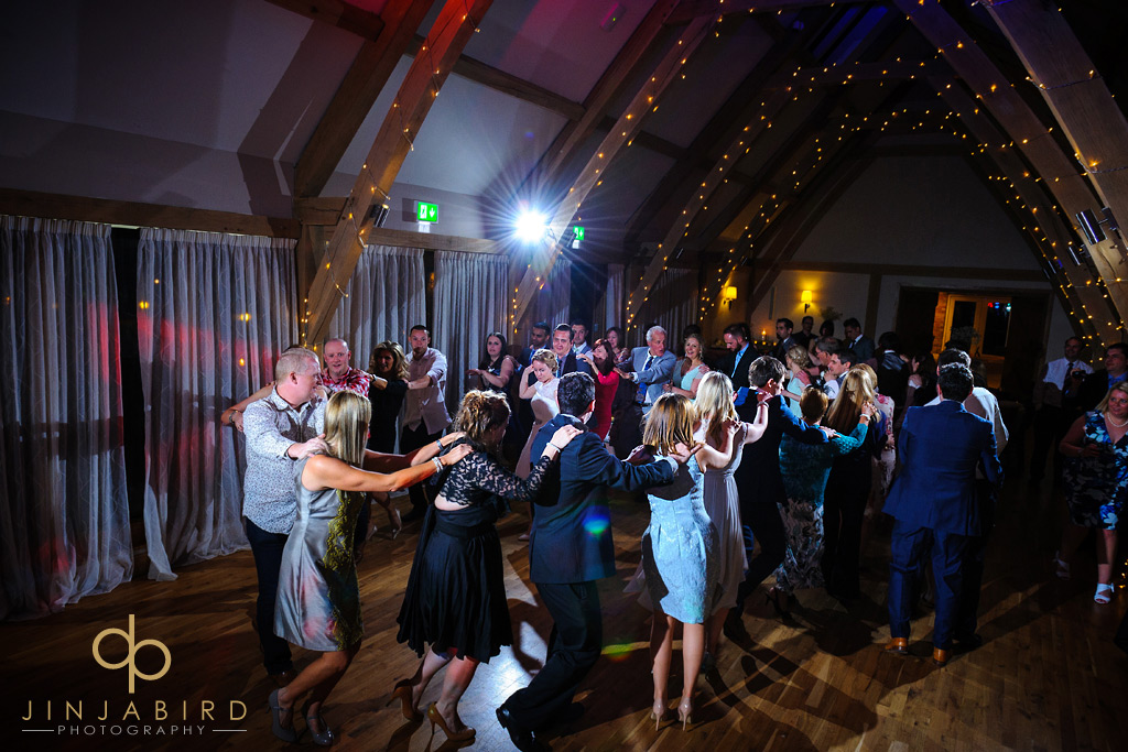conga-dance-at-wedding-bassemad-manor-barns