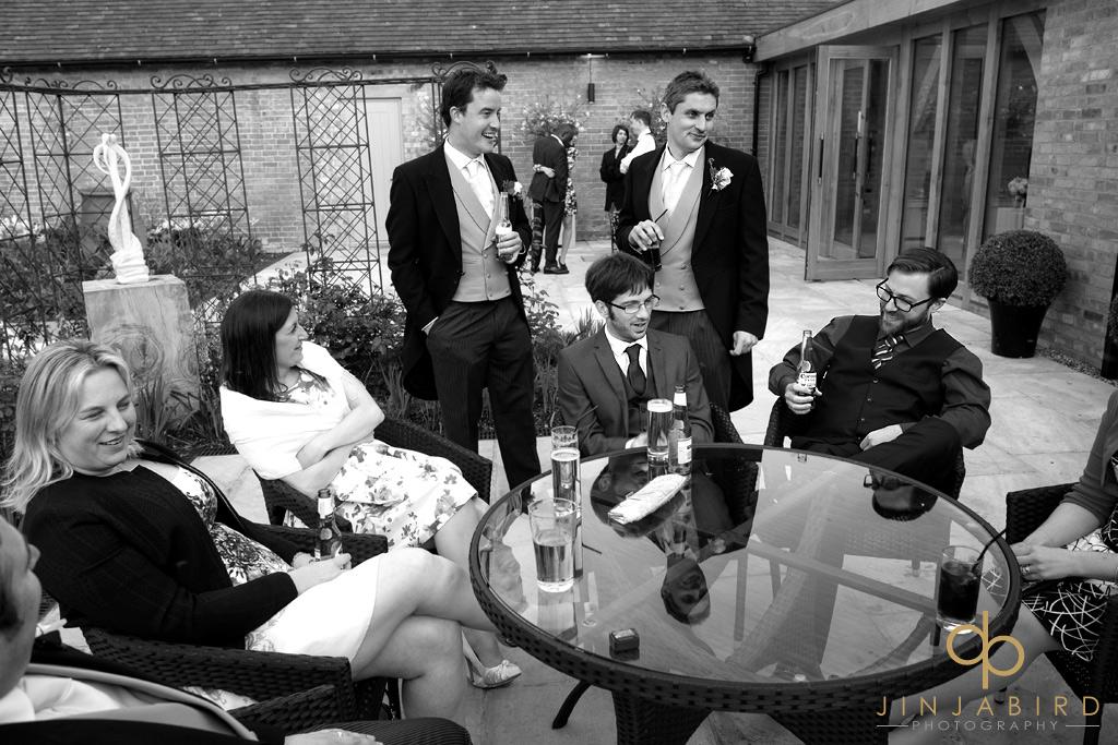 groom-talking-to-guests-bassmead-manor