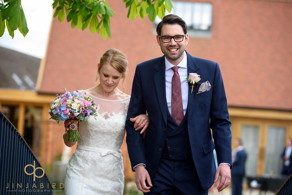 groom-walking-with-bride-bassmead-manor