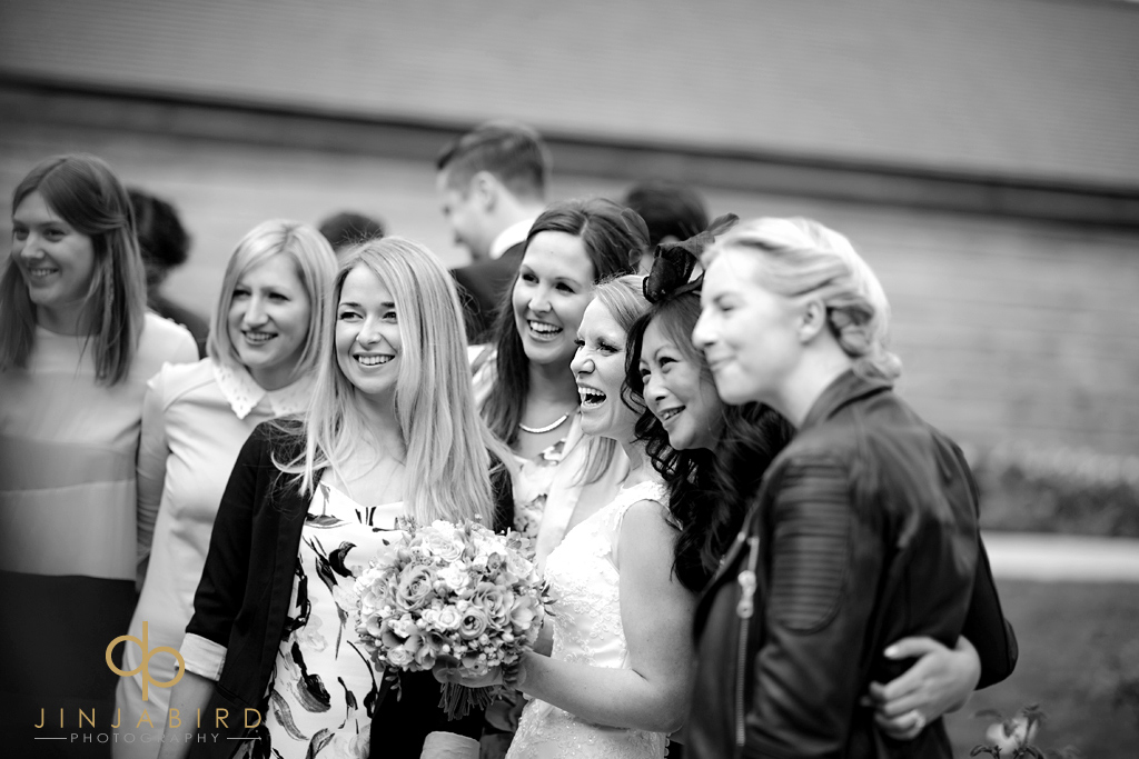 groom-with-girlfriends-bassmead-manor-barns