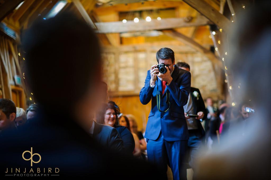 wedding-guest-taking-photos-bassmead-manor-barns