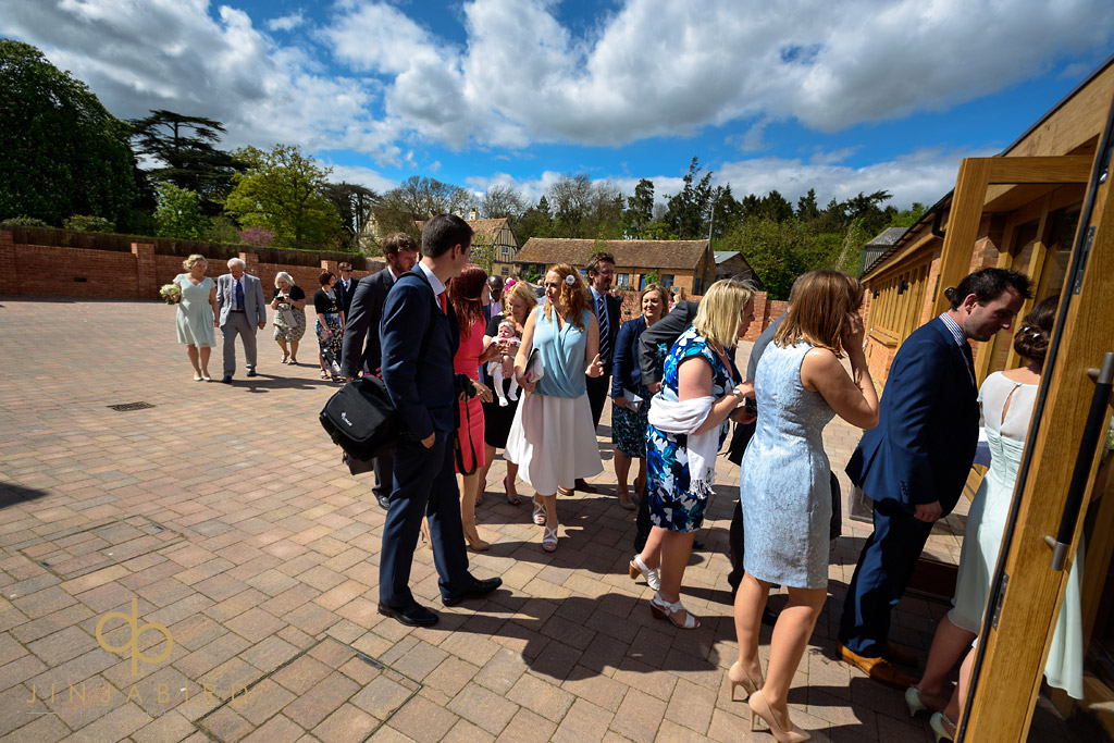 wedding-guests-at-bassmead-manor-barns