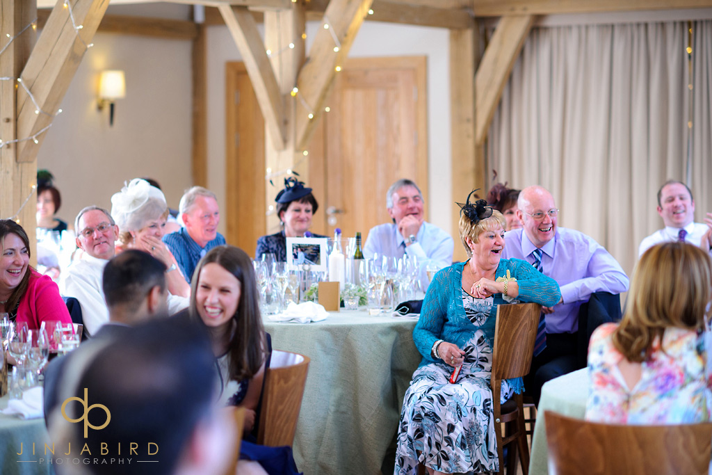 wedding-guests-during-speeches-bassmead-manor-barns