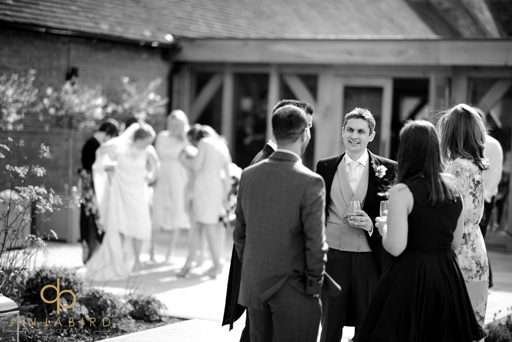 wedding-guests-enjoying-garden-bassmead-manor-barns