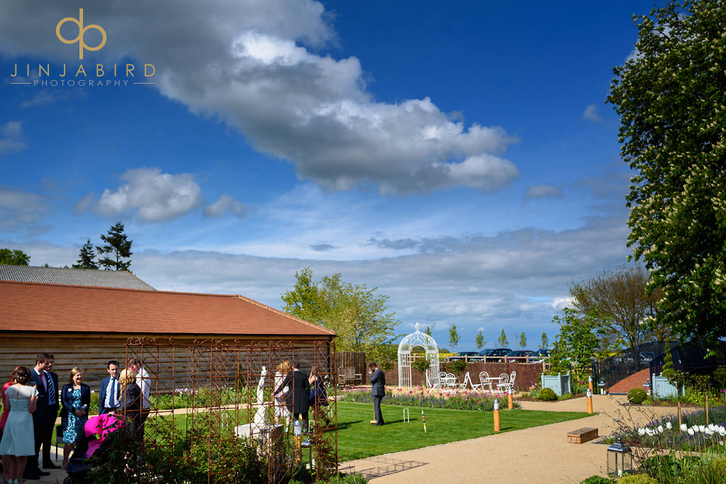 wedding-guests-in-garden-bassmead-manor-barns