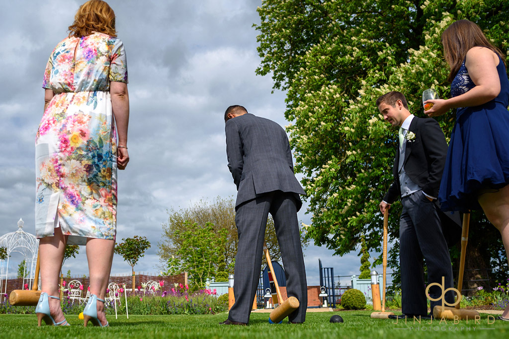 wedding-guests-playing-croquet-bassmead-manor-barns