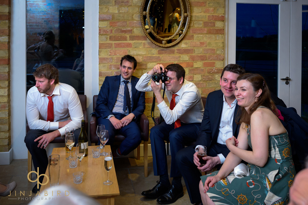 wedding-guests-taking-photos-bassemad-manor-barns