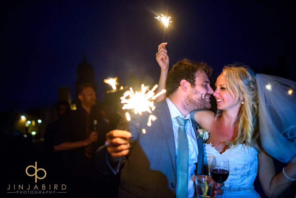 bride-and-groom-with-sparklers-burghley-house