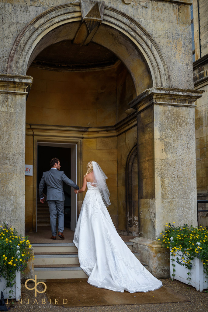 bride-on-stairs-burghley-house