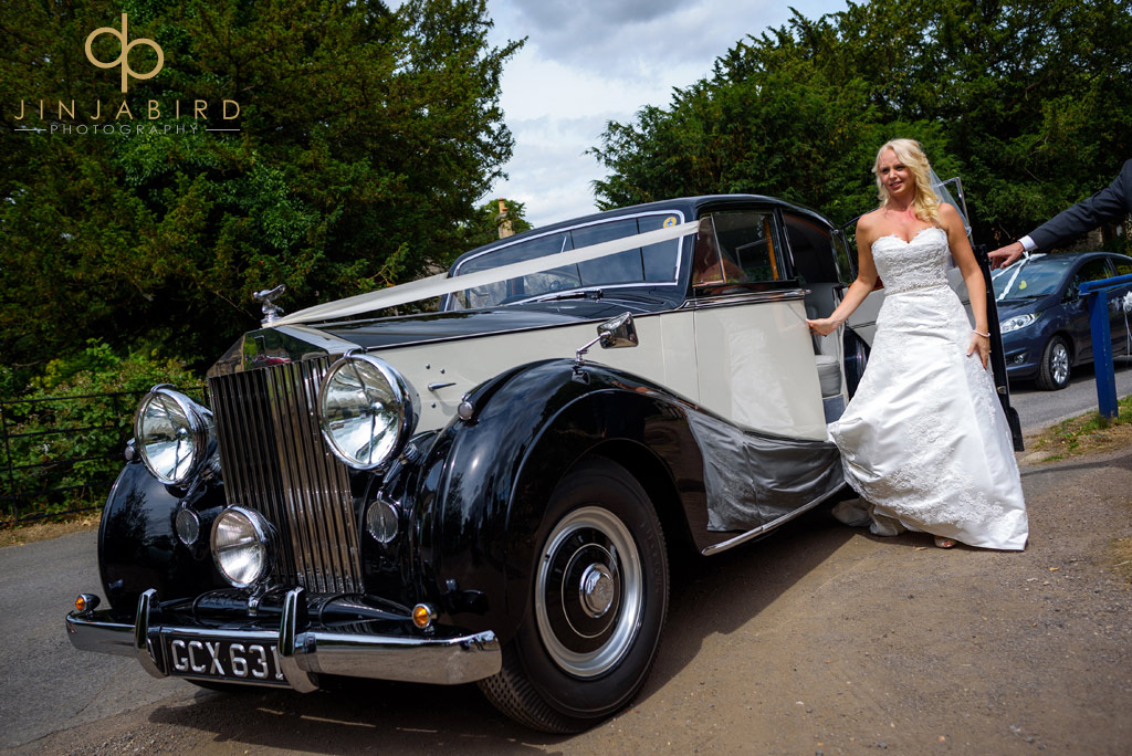 bride-with-car-at-stoke-rochford-church