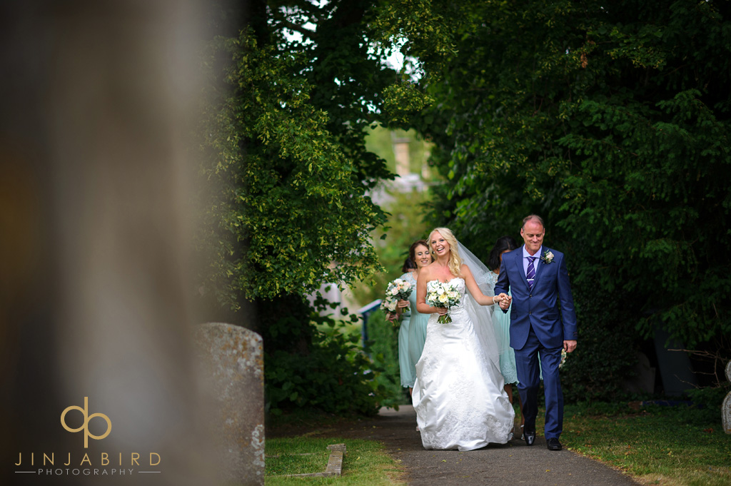 bride-with-father-at-stoke-rochford-hall