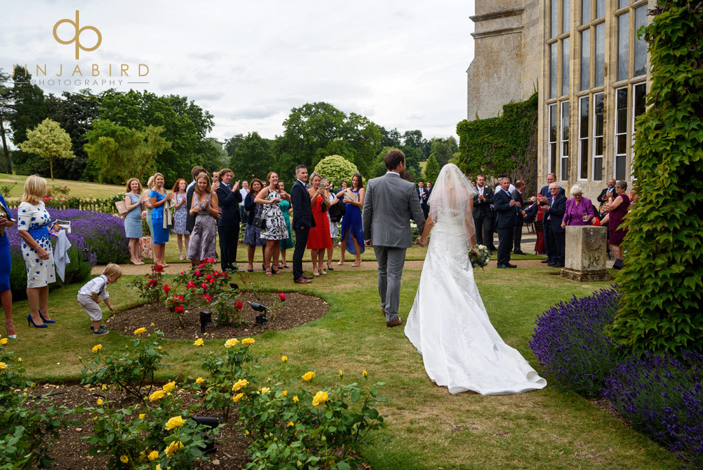 bride-with-groom-in-rosegarden-burghley-house
