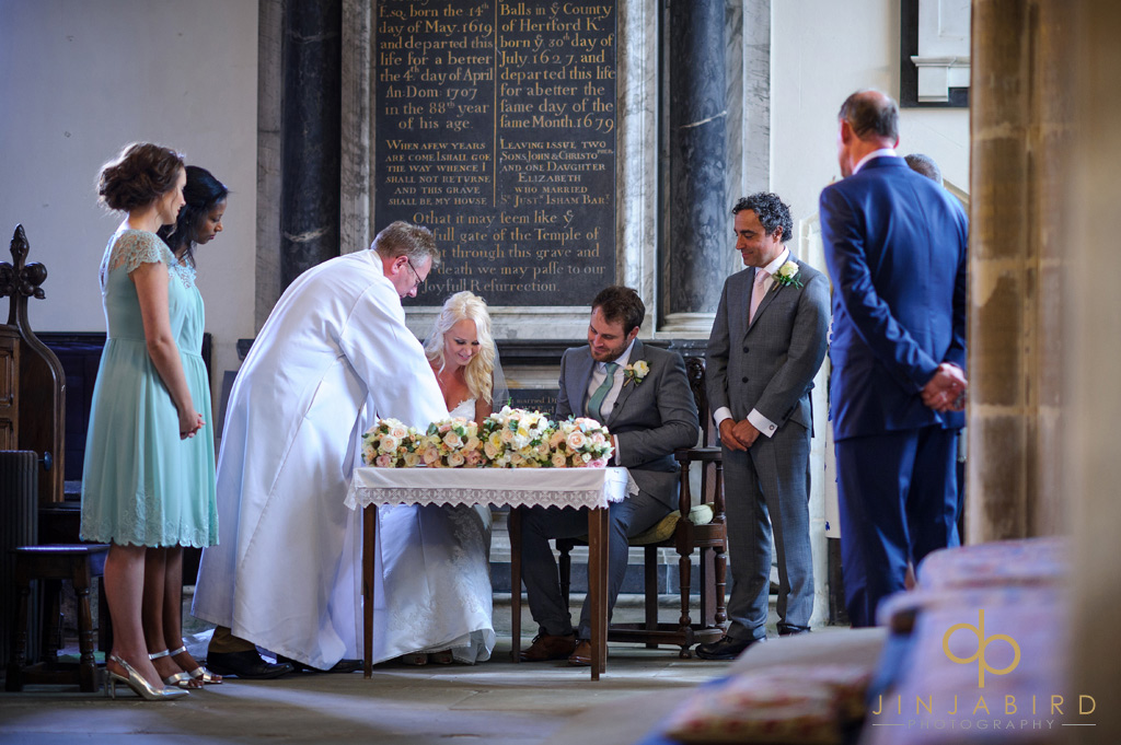 signing-the-wedding-register-at-stoke-rochford-church