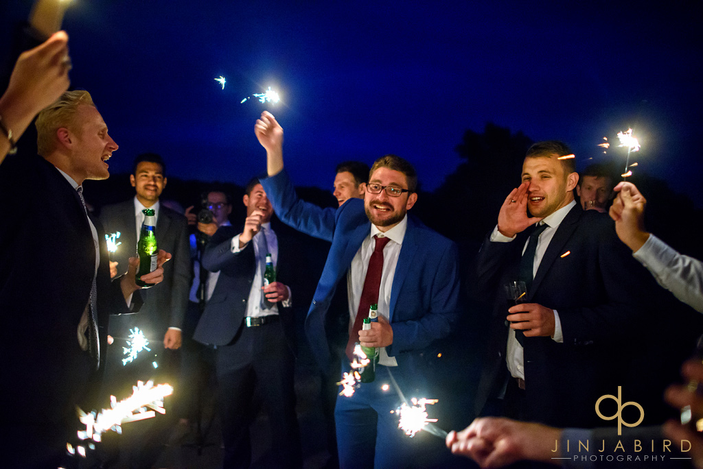 wedding-guests-with-sparklers-burghley-house