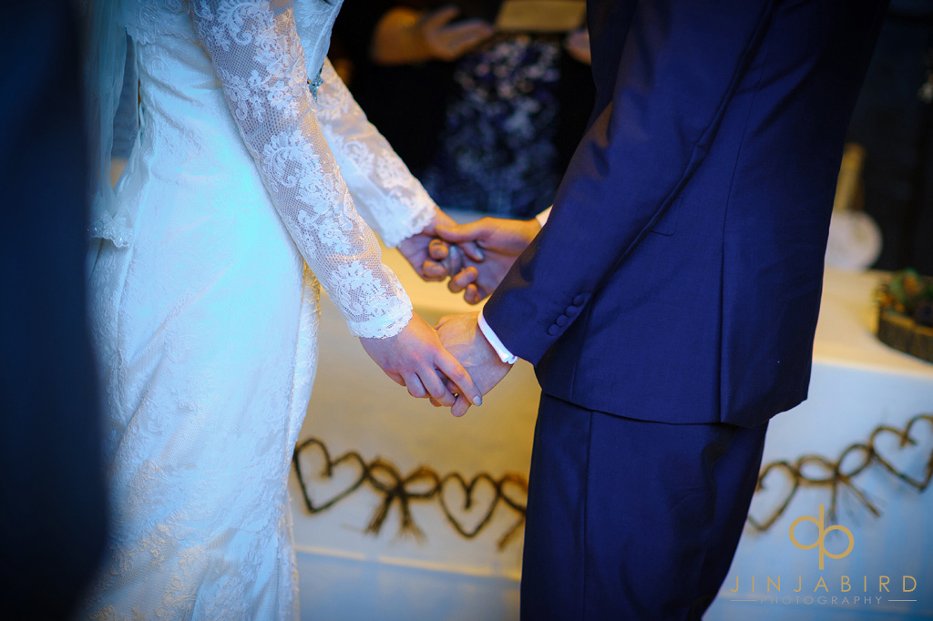 bride-and-groom-holding-hands-hunsburry-hill-centre